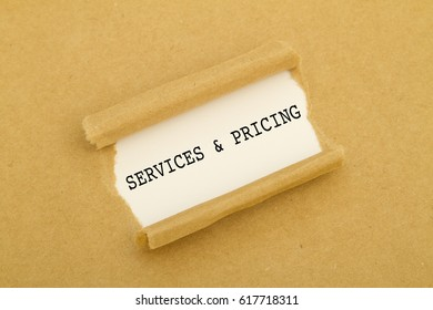 SERVICES and PRICING word written under torn paper.