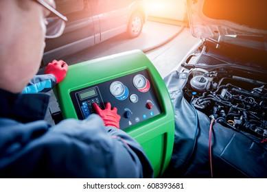 Servicing car air conditioner. Service station. Car repair.