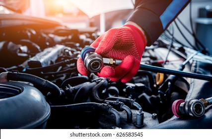 Servicing car air conditioner. Service station. Car repair.