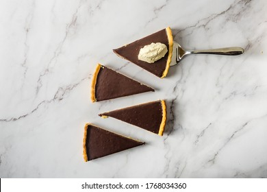 Serving Chocolat tart with homemade whipped cream