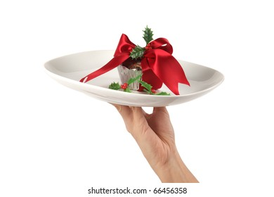 serving a decorated fruitcake in a plate