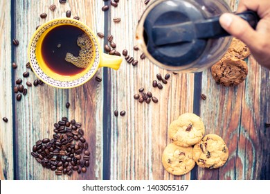 Serving delicious American coffee with cookies
