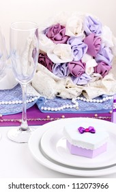 Serving fabulous wedding table in purple color isolated on white
