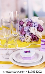 Serving fabulous wedding table in purple and yellow color of the restaurant background