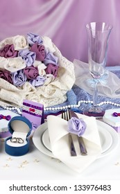 Serving fabulous wedding table in purple color on white and purple fabric background