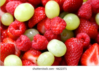Serving of fresh fruit, strawberries, grapes and raspberries.