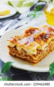 serving freshly cooked lasagna on the dining table. italian cuisine.