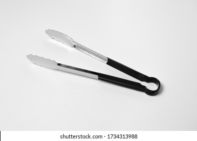 Serving kitchen cooking Tongs isolated on a white Background.High resolution photo.