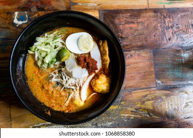 Serving of Nyonya Laksa, popular spicy noodle soup delicacy in Malaysia