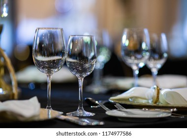 Serving on the table. Crystal glasses
