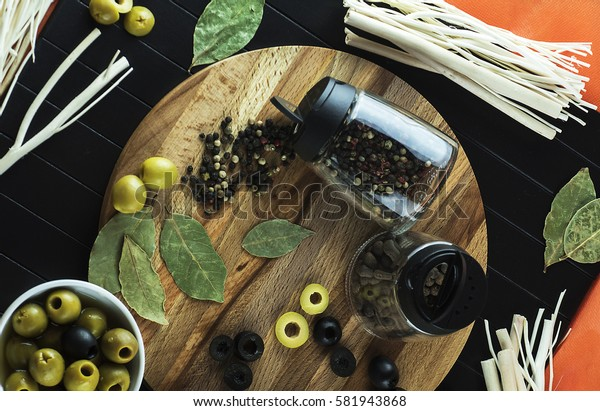 Serving on the table of useful, tasty little fish sprat, condiments, olives and decor. The view from the top