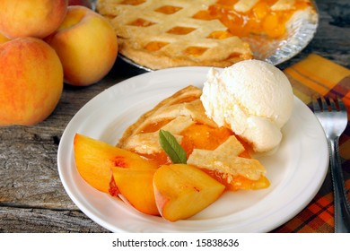 A serving of peach pie with ice cream.