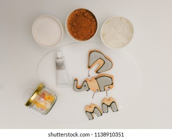 a serving plate of cute 3D puzzle elephant cookies with Chocolate-hazelnut paste, Marshmallow and topping suger rock,brown suger,white suger,