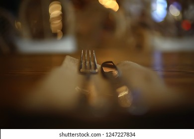serving in the restaurant, fork and knife / interior view of the restaurant with a table served knife and fork on the table in a cafe