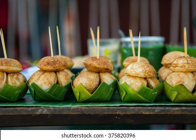 Serving set of coconut milk cake (Ka-Nom-Krok in Thai) using banana leaf as a container