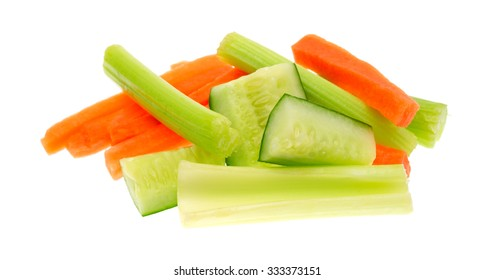 A serving of snack vegetables with cucumbers celery and carrots isolated on a white background.