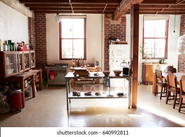 Serving table in the kitchen dining room of a loft apartment