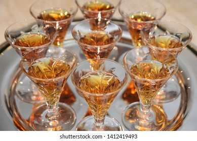 A serving tray with shots of cognac