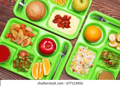Serving trays with delicious food on table. Concept of school lunch