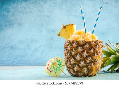 Serving tropical ice granita in pineapple, copy space.