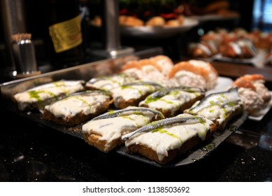 Servings of various pintxos or tapas at a bar in San Sebastian, Spain.  The city is famously known for its cuisine.