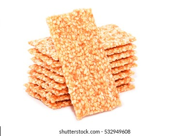 Sesame bars with honey isolated on white