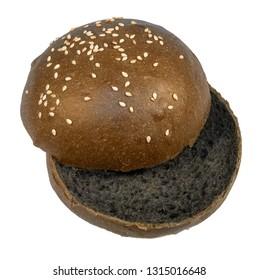 Sesame bun for hamburger cut black isolated on white background