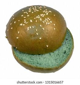 Sesame bun hamburger sliced green on white background