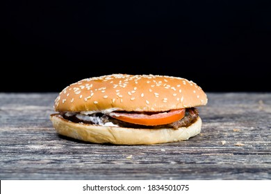 sesame bun stuffed with meat, cheese, and herbs, inexpensive fast food , unhealthy food