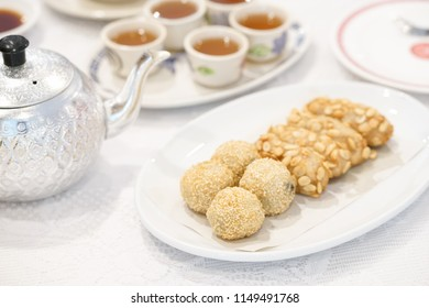 sesame dessert. A soft focus photo of Chinese sweet of sesame balls (sweet dumpling with black sesame filling inside) and fried taro served with ginger tea.