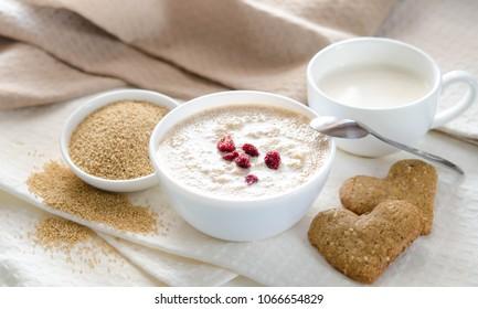 Sesame dry cookies in the form of heart and yogurt, healthy breakfast