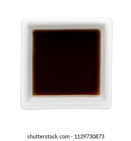Sesame oil in a square bowl isolated on white background