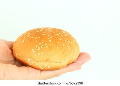 The sesame seed bun on hand for you