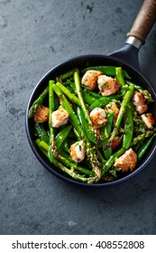 Sesame Seed Chicken with Green Asparagus and Sugar Snap Peas. Home made food. Paleo diet recipe