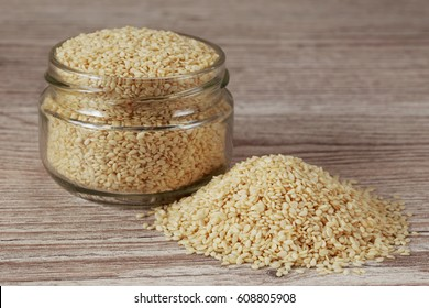 Sesame seed in a jar on wooden background