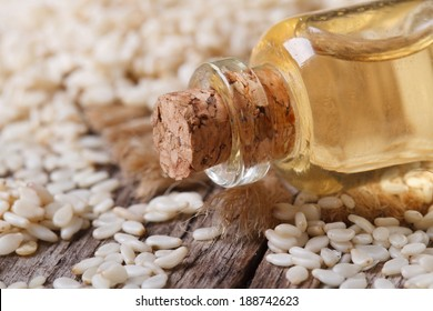 sesame seed oil in a glass bottle with a cork on the table macro horizontal