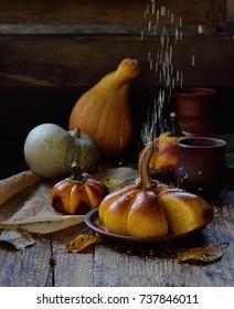 Sesame seeds fall on pumpkin bread