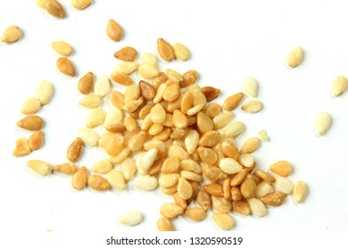 Sesame seeds isolated on white background, top view. macro photography