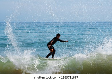 Sesimbra, Portugal April 2018 local skim board surfers are practicing before competition