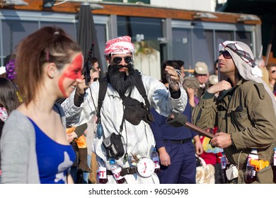 SESIMBRA, PORTUGAL - FEBRUARY 20: Man dressed up as Bin Laden in the Sesimbra Carnival – equal to the Brazilian Carnival on February 20, 2012 in Sesimbra, Portugal.