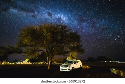 Sesriem, Namibia - 20 MAY 2017:  Toyota Hilux with Roof top tent and the galaxy at the sky.  Milky Way over Sesriem camping site, Namibia.