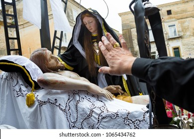 SESSA AURUNCA, ITALY - MARCH 30-31, 2018 - A woman welcomes Vergine Addolorata during the Easter procession on Holy Saturday in Sessa Aurunca, Italy