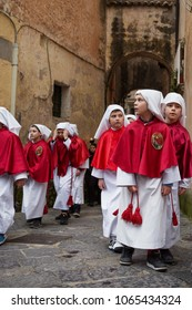 SESSA AURUNCA, ITALY - MARCH 31, 2018 - On Easter Holy Saturday two parades walk unified: the greens and the reds carry two groups of statues, the Deposizione del Cristo and the Vergine Addolorata