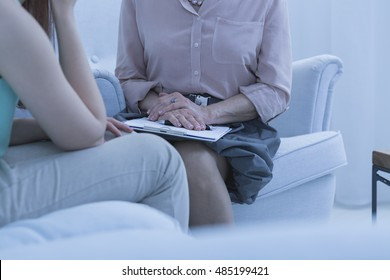 Session of the female patient and female doctor  in the doctor's office
