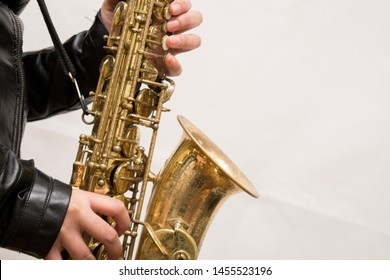session playing the tall golden saxophone.