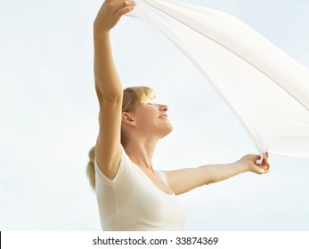 Session of a relaxation on a background of the years sky of the girl in white