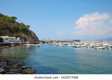 SESTRI LEVANTE, ITALY - AUGUST 23, 2018: Sestri Levante coast, harbour and pier in a sunny summer day in Italy