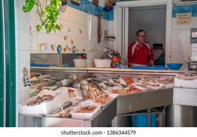 Sestri Levante, Liguria / Italy - April 21 2019: Interior of a fish shop with the fresh fish of the day and the fishmonger in the background in the ancient fishing village of Sestri Levante, Genoa