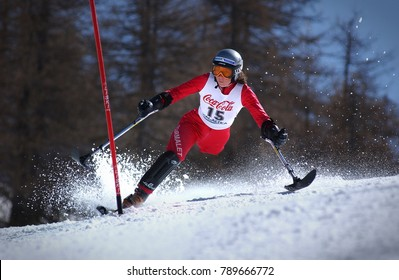 Sestriere, Italy - February 14, 2011: Athlete woman with physical disabilities trains in alpine skiing slalom