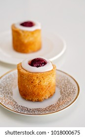 Set for 2. Runeberg's tart or cake is a Finnish traditional dessert and pastry that is originally made of gingerbread and bread crumbs, almonds, while rasberry jam and sugar on top